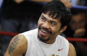 boxer-manny-pacquiao-smiles-during-a-media-workout-at-wild-card-boxing-club-in-los-angeles-calif-oct-26-2011
