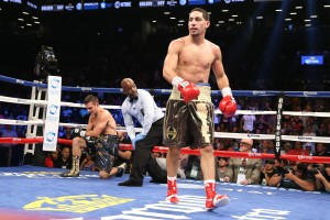 BROOKLYN, NY - AUGUST 9: Danny Garcia (Brown/Gold trunks) knocks down Rod Salka (Black/Gold trunks) during their fight at the Barclays Center on August 9, 2014 in Brooklyn, New York. (Photo by Ed Mulholland/Getty Images)