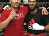 Anthony Sims Jr. helps Caleb Truax prepare for Anthony Dirrell