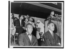 Elijah Muhammad addresses followers including Cassius Clay / World Telegram & Sun photo by Stanley Wolfson. Library of Congress.